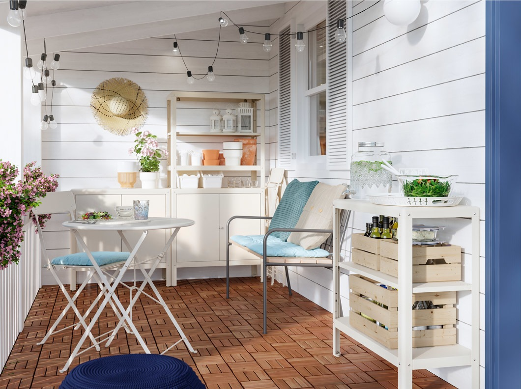 IKEA KOLBJÖRN off-white shelving unit can be used indoors and outdoors. It has two shelves and can stack to create a higher unit.