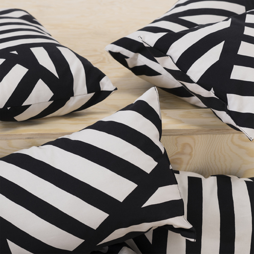 Black and white striped cushions on a wooden step.