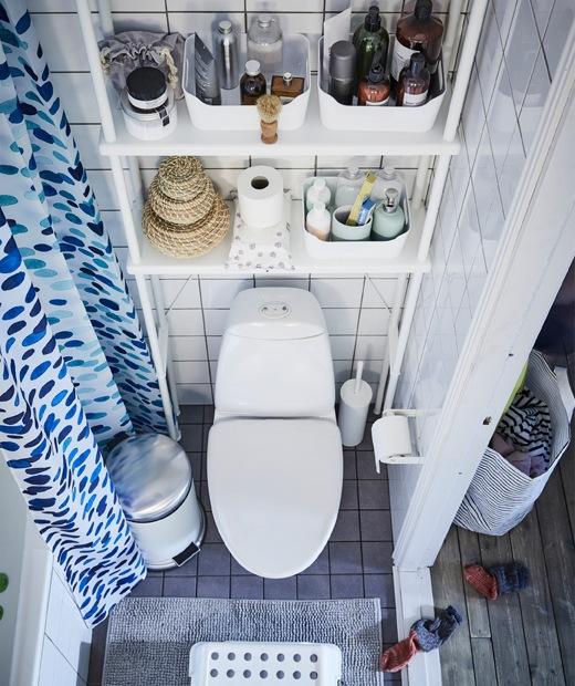Toiletries on storage shelves above a toilet.