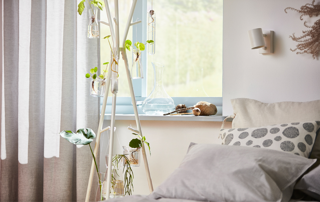 A white EKRAR hat and coat hanger is perfect for decorating with homegrown baby plants.