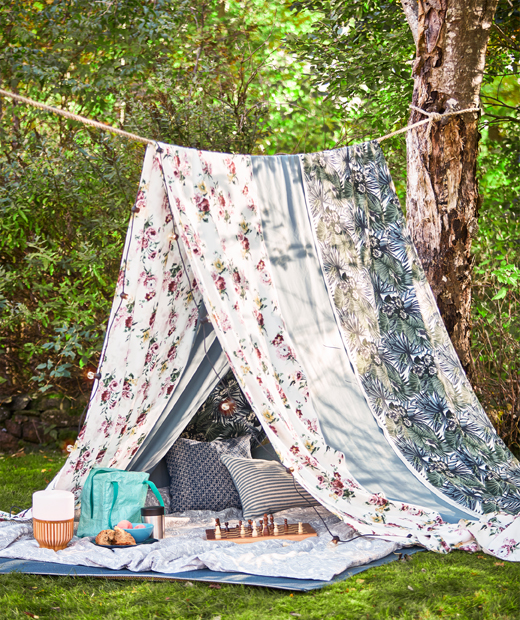 A rope between two trees and long pieces of fabric like multicoloured EMMIE ROS make a summer tent for picnics.