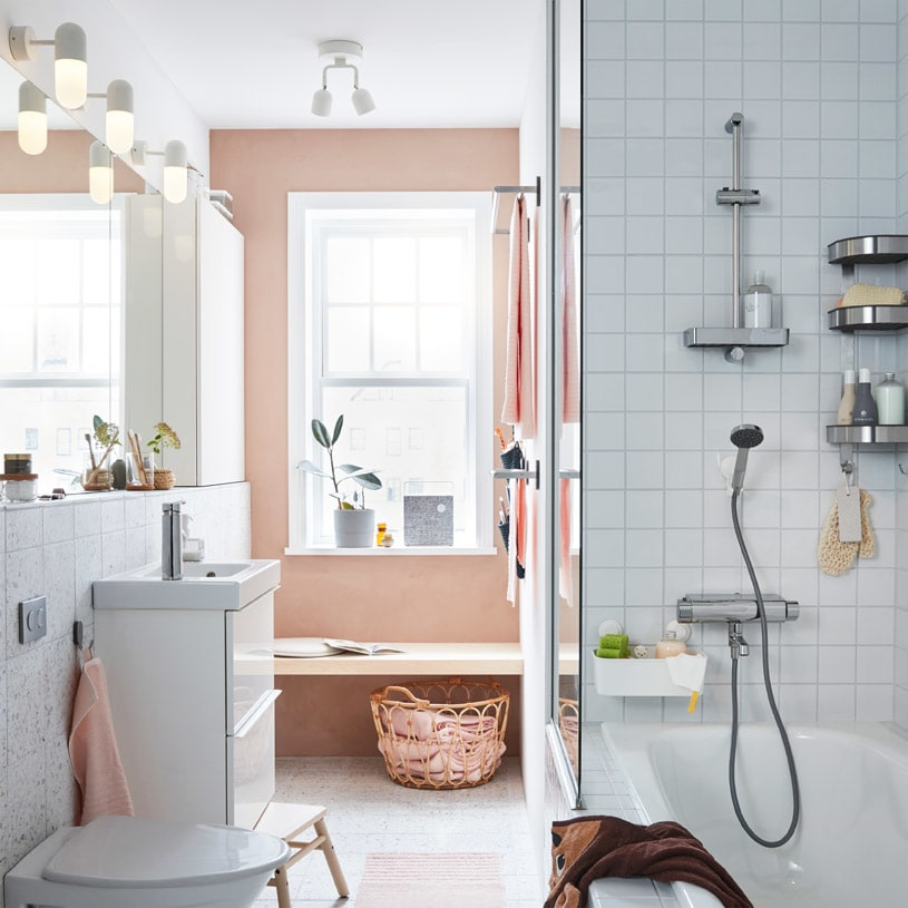 IKEA GODMORGON wash stand is ideal for small space bathrooms, followed with a row of GODMORGON mirrors and glossy white wall cabinets to hold all your bathroom supplies.