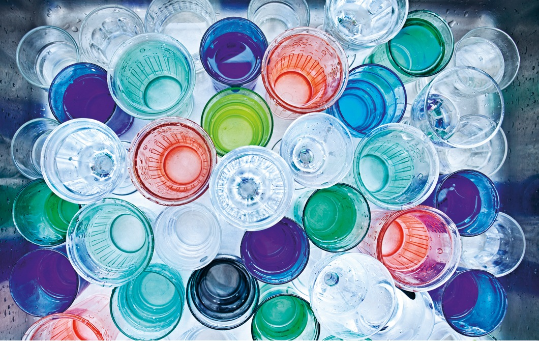 A collection of colourful water glasses.