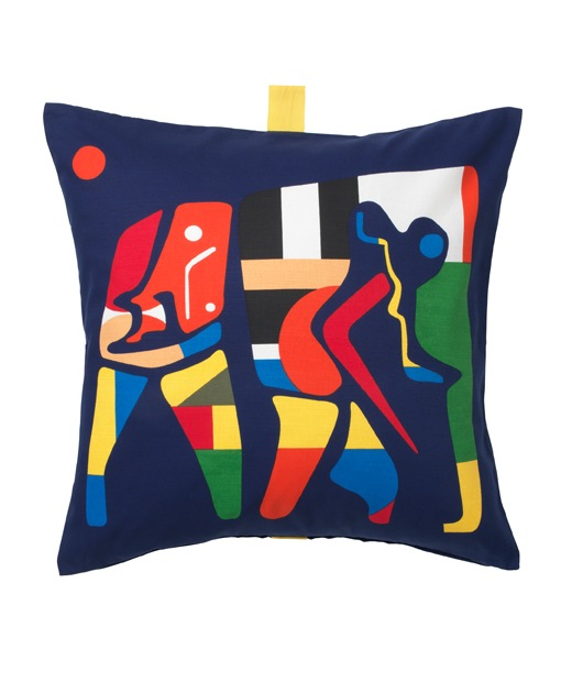 A dark blue cushion with colourful elephant motif on a white background.