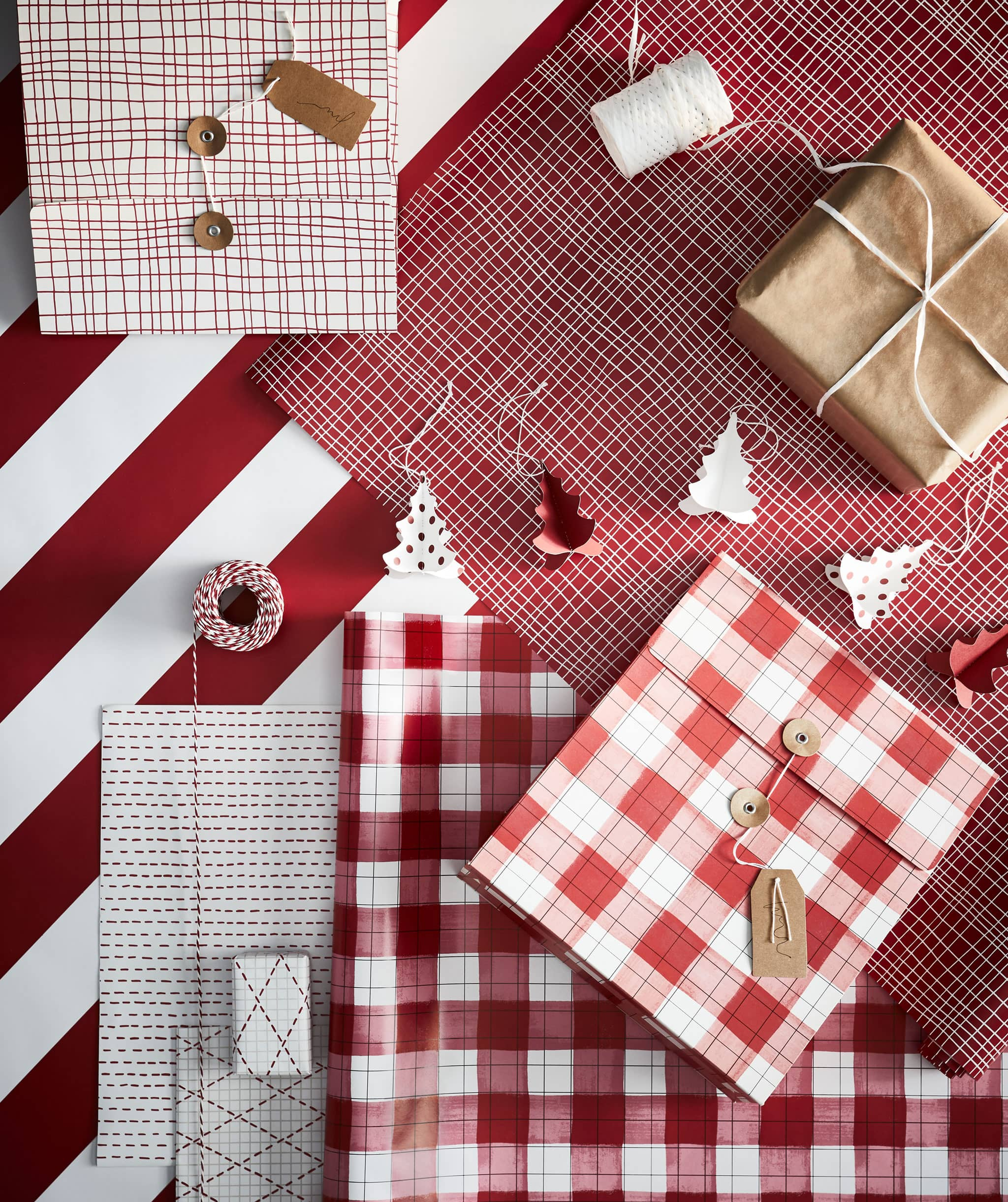Station for gift-wrapping with all in place: paper in various colours and patterns, string, scissors, tags and boxed gifts.