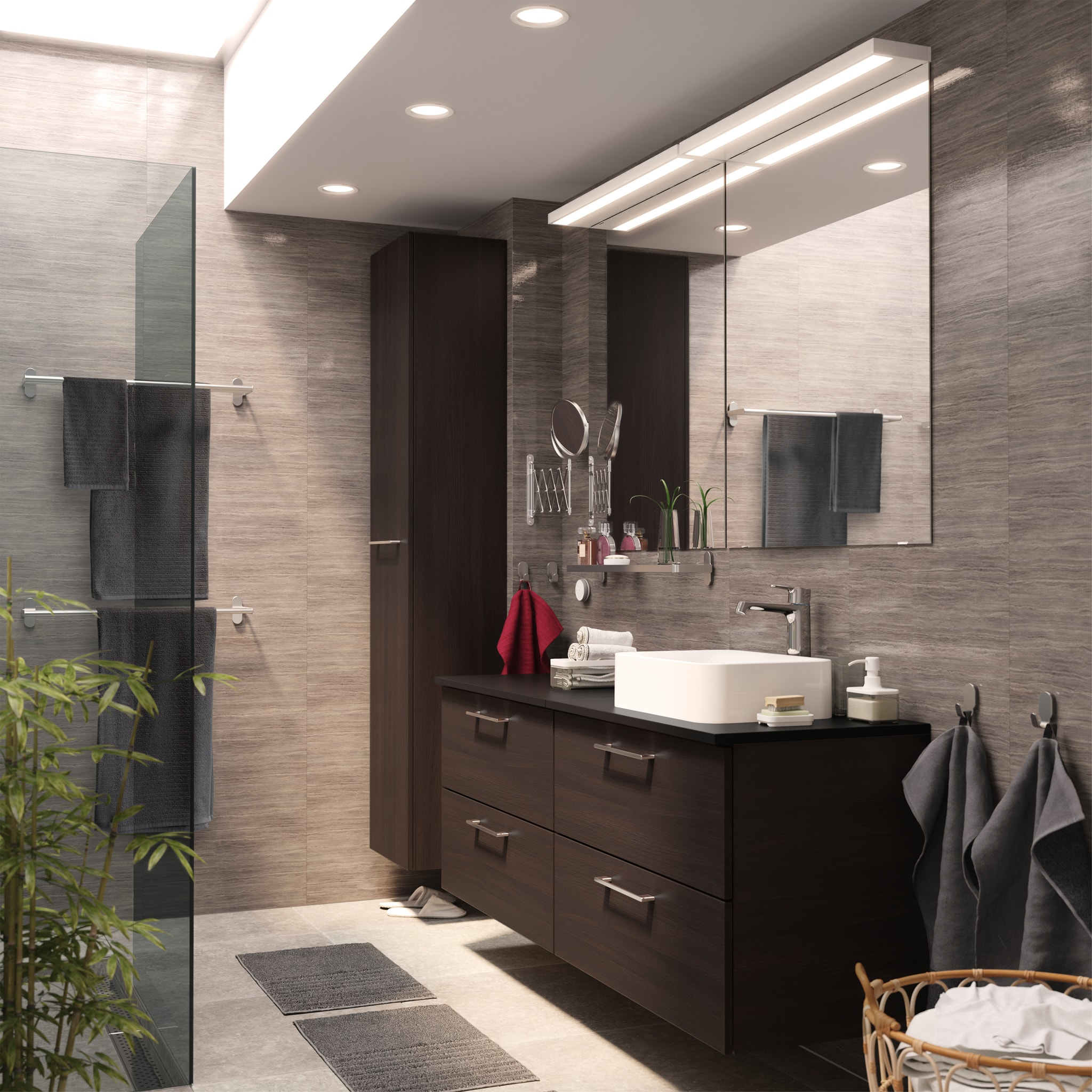 Bathroom with a streamlined, seamless look thanks to two GODMORGON wash stands and a GODMORGON high cabinet in black-brown.