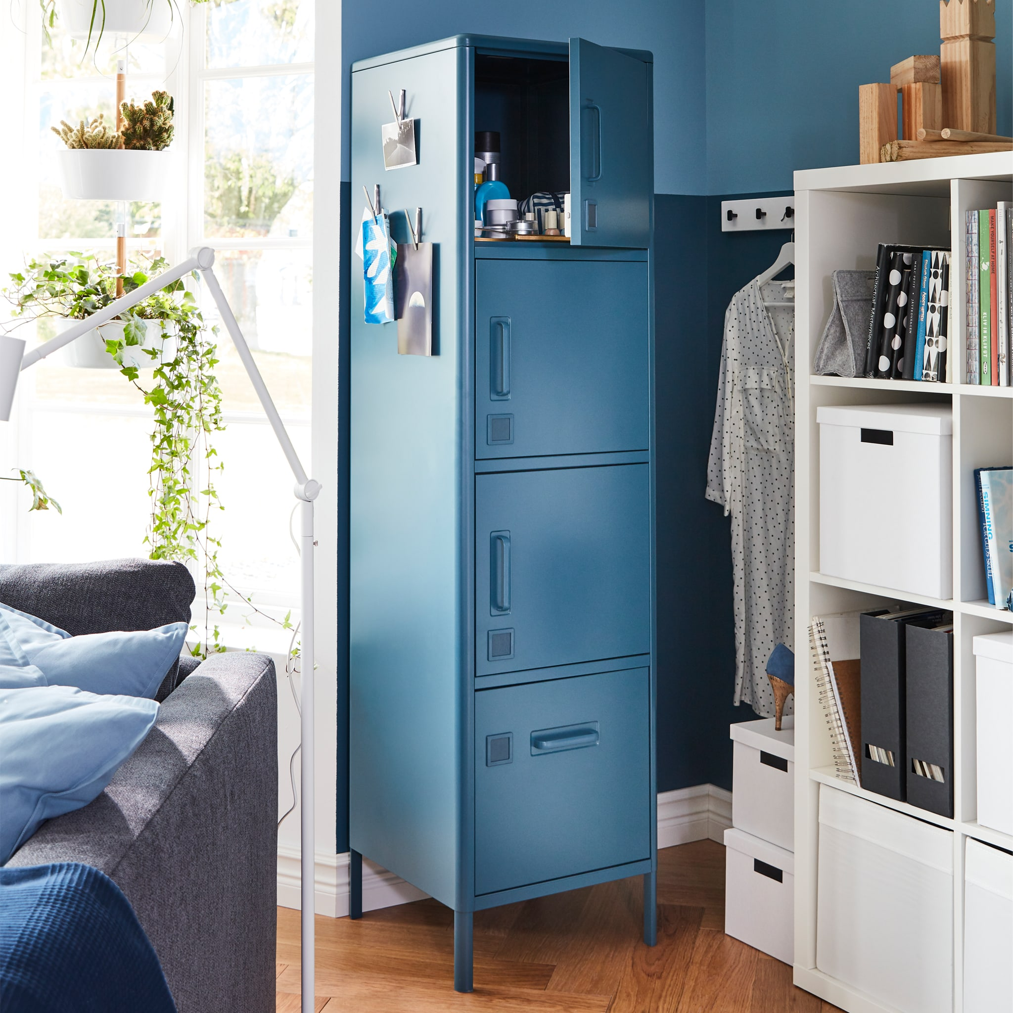 Next to a window is a narrow wall where IDÅSEN high cabinet with four doors fits perfectly since it's narrow too.