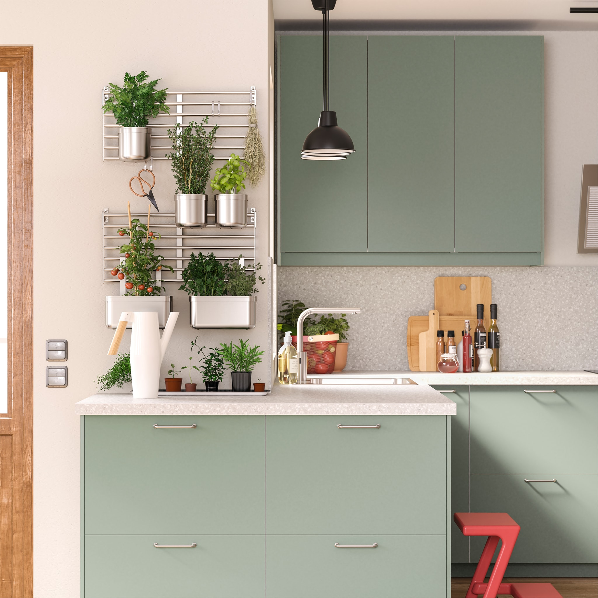 Grey-green kitchen with wall-mounted wall grids in stainless steel with plant pots that hold different herbs and vegetables.