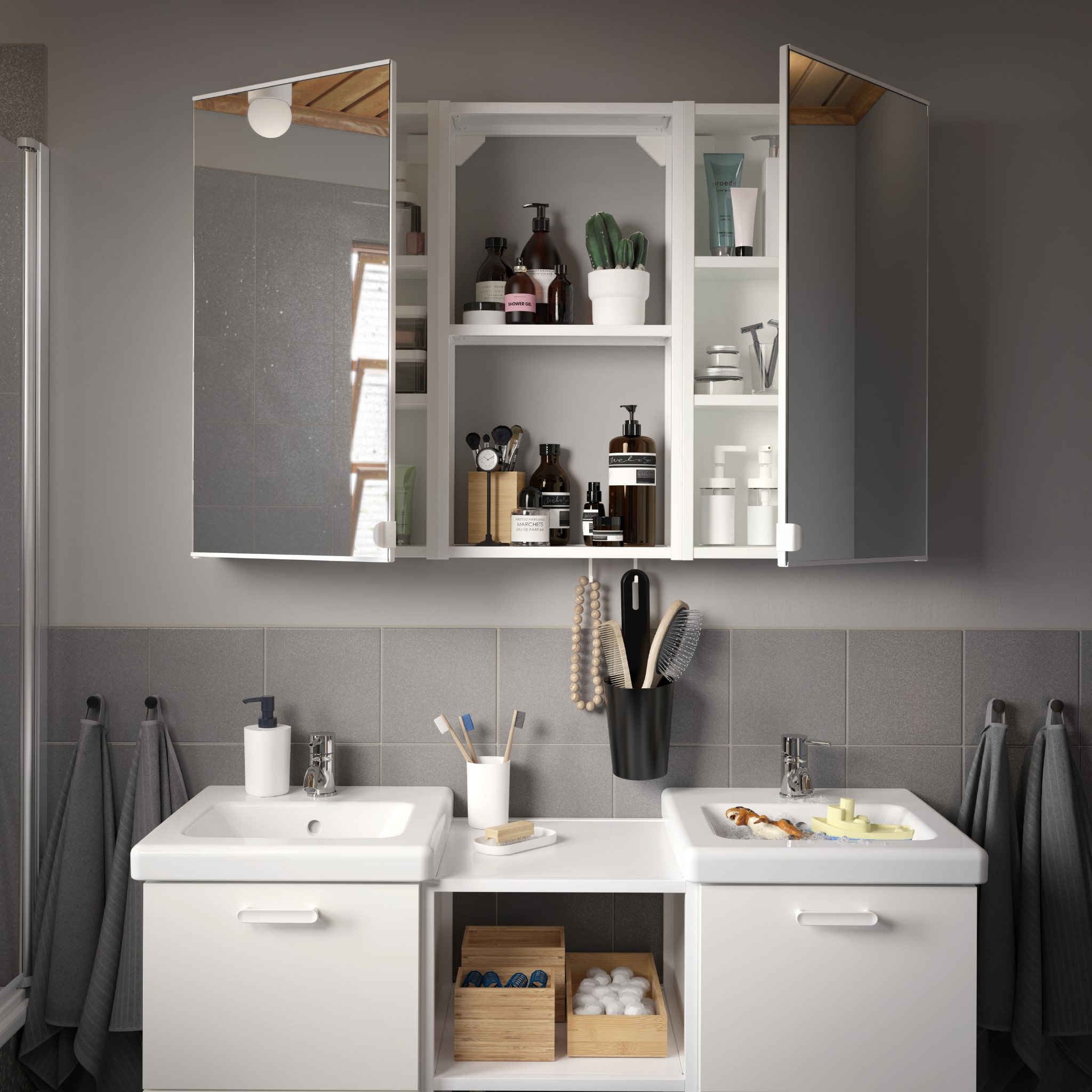 A grey/grey-tiled bathroom with a wash-stand/wash-basin in white, a wall cabinet with two mirror doors and four grey towels.