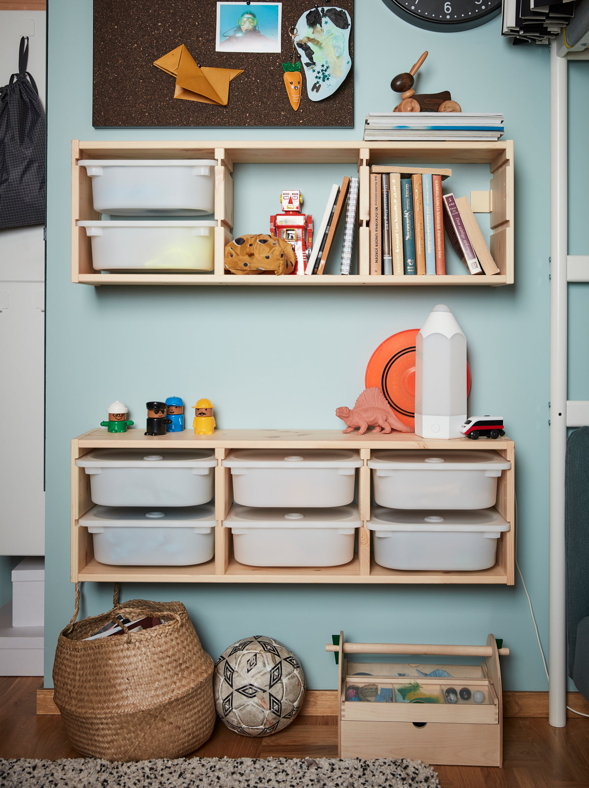 Two units of wall storage from the children's series TROFAST made from wooden frames and white plastic boxes.